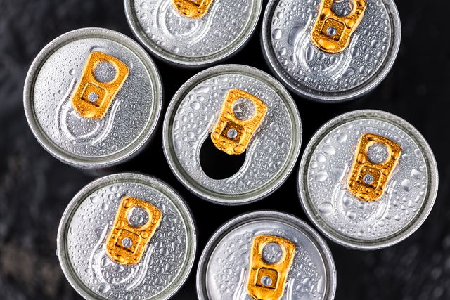 some energy drinks on a dark slate slab
