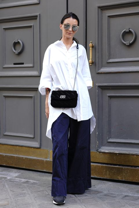 White, Clothing, Street fashion, Fashion, Standing, Shoulder, Sleeve, Footwear, Uniform, Trousers,