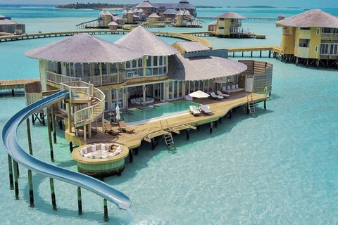 Seaside resort, House, Real estate, Vacation, Architecture, Building, Tourist attraction, Resort, Home, Tourism,