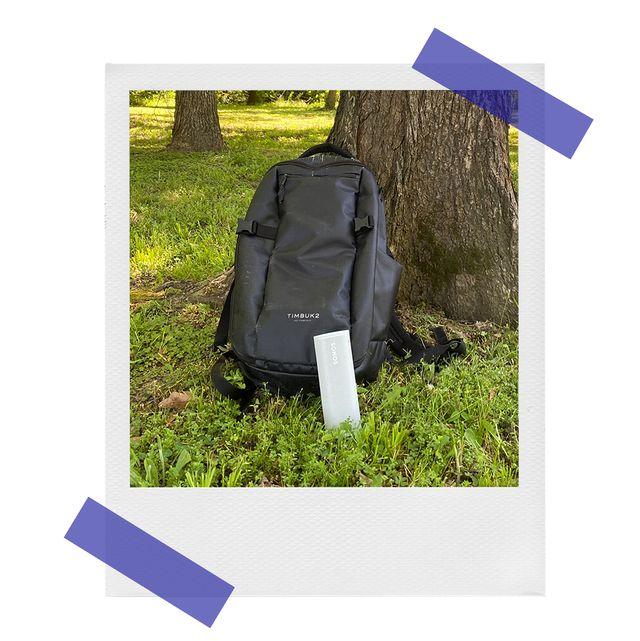 sonos roam speaker near backpack in the woods
