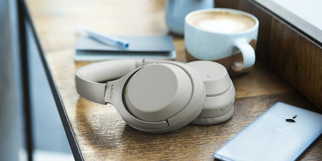 sony headphones on counter with coffee and phone