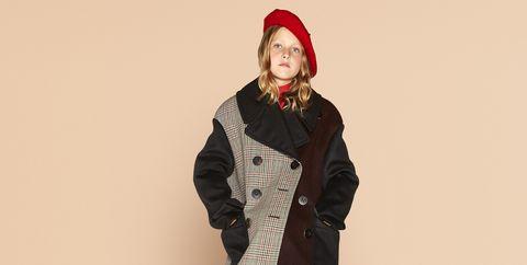 Clothing, Standing, Coat, Fashion, Outerwear, Jacket, Headgear, Overcoat, Beige, Fur,