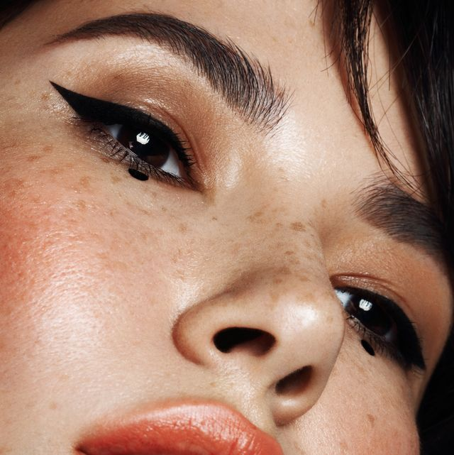 Portrait of beautiful woman with cat eye make-up