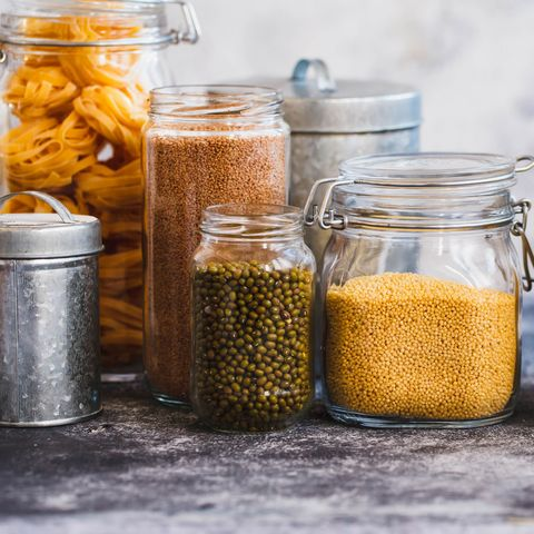Soybeans, Quinoa, Bulgur And Couscous Cereals In Glass Jars
