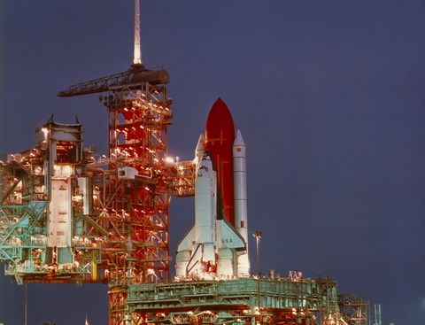 Columbia space shuttle on the launch pad at night