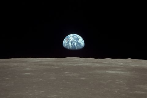 """Spaceflight United States of America, Moon landing of Apollo 11 in 1969: View from lunar module """"Eagle"""": earthrise sequence - earth rises over lunar horizon - July 20, 1969"""
