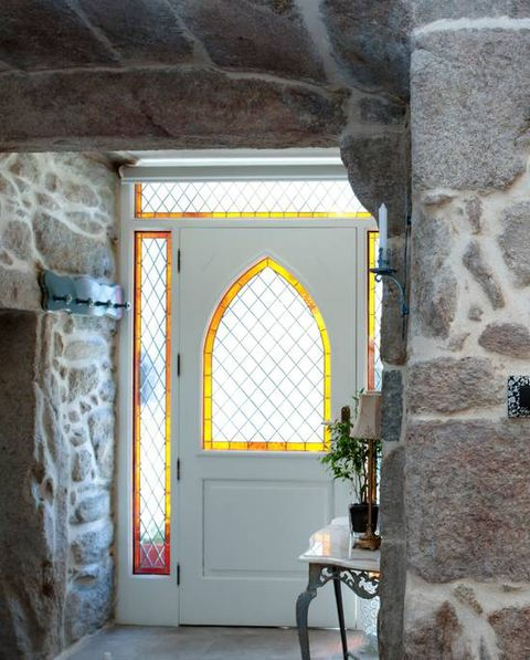 Wall, Yellow, Property, Room, Arch, Lighting, Interior design, Building, Stone wall, Architecture,