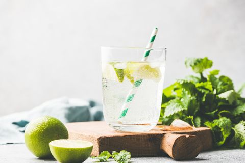 sparkling summer cocktail with lime and mint