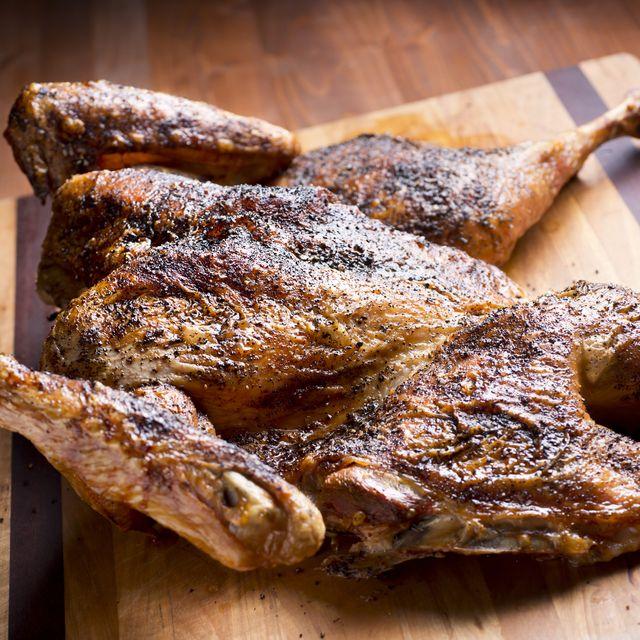 spatchcock split open turkey on a wood cutting board
