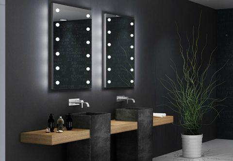 Lo specchio moderno illuminato di Cantoni