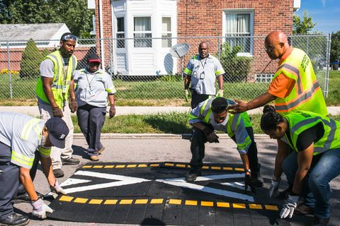 workers installing speed humps in detroit