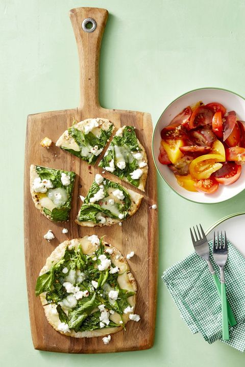 spinach and cheese pita pizzas with tomato salad