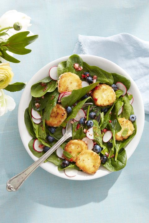 Spinach and Mint Salad with Crispy Goat Cheese in a bowl