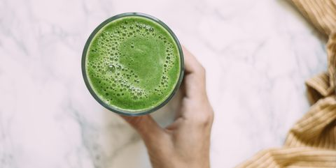 Spinach smoothie on marble background
