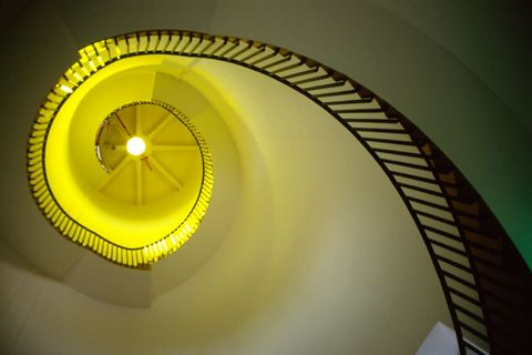 spiral staircase with yellow tinge interior southwold lighthouse, suffolk, england, uk