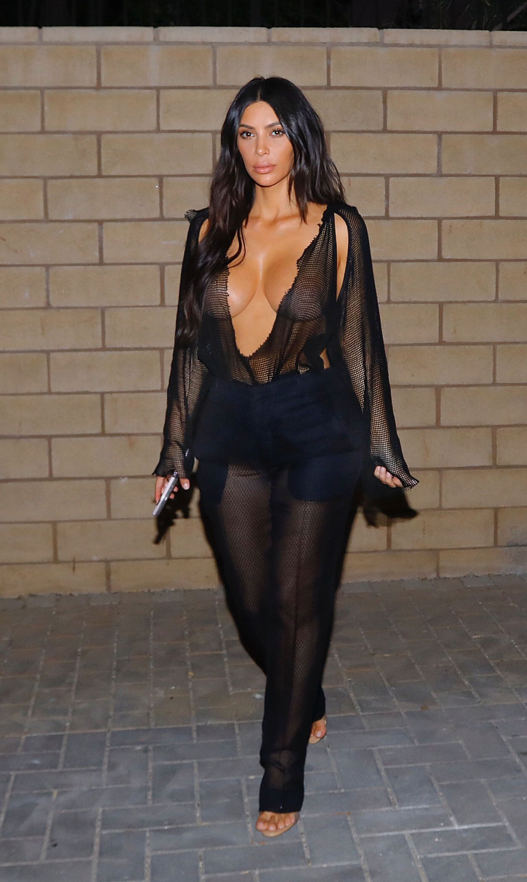 Kim Kardashian Wears Black Fishnet Jumpsuit Kim Goes Braless In