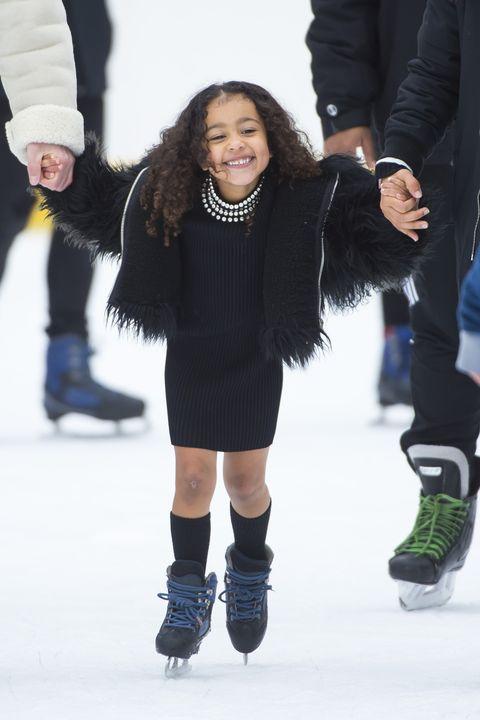Ice skating, Fashion, Footwear, Ice rink, Recreation, Winter, Knee, Human, Joint, Fur,
