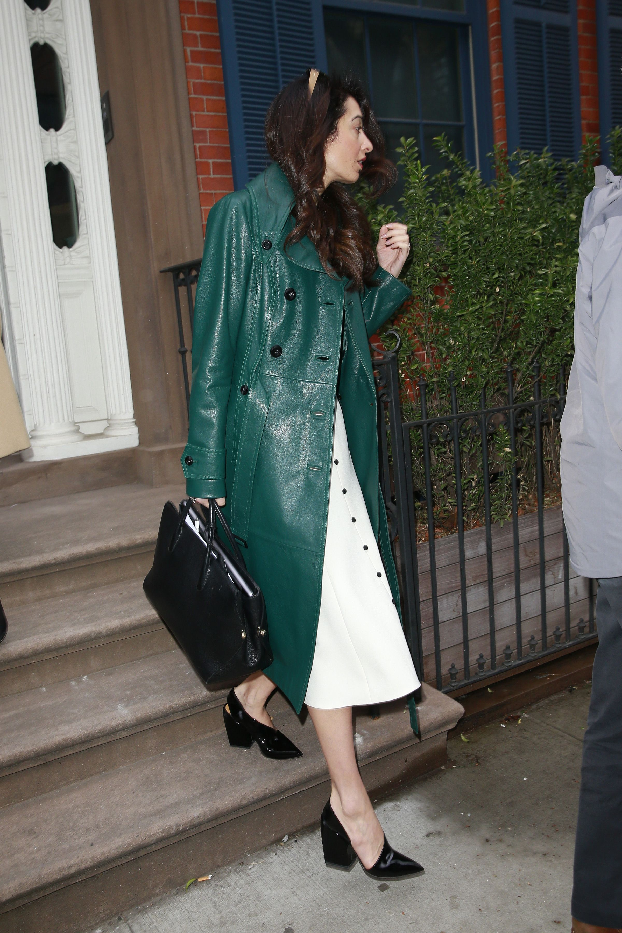 April 3, 2018 In a green Michael Kors Collection trench coat while out in New York City.