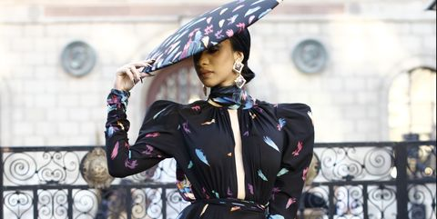 6ab8f83f992 Here s Cardi B Literally Peacocking in a Massive Michael Costello Dress at  Paris Fashion Week