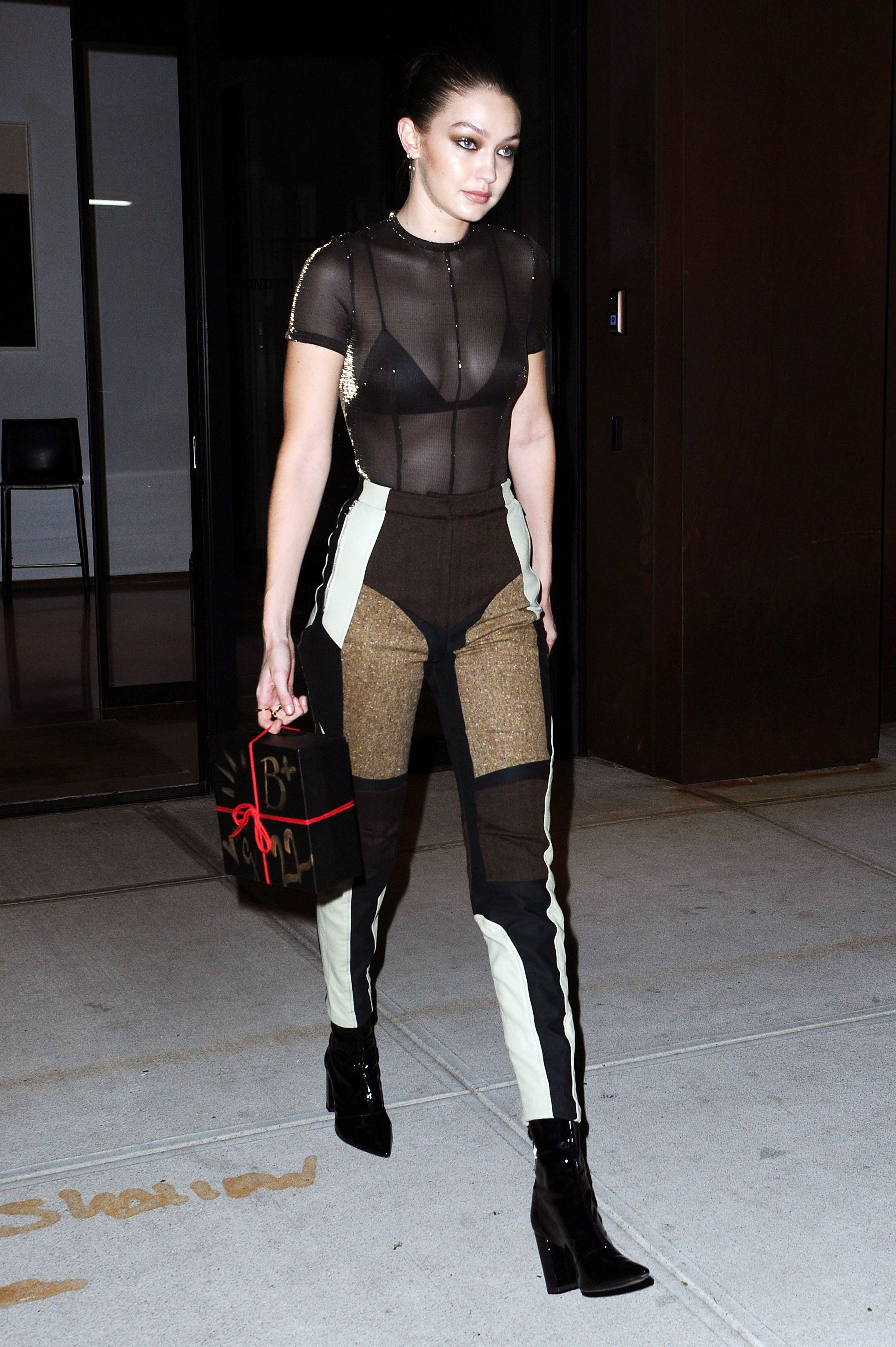October 9, 2018 Gigi attended her sister's 22nd birthday in a sheer top that exposed her black Fleur du Mal bralette and wore patchwork-inspired pants. To give her outfit that edgy feel, she wore heavy dark eyeliner and kept her accessories strictly black too.
