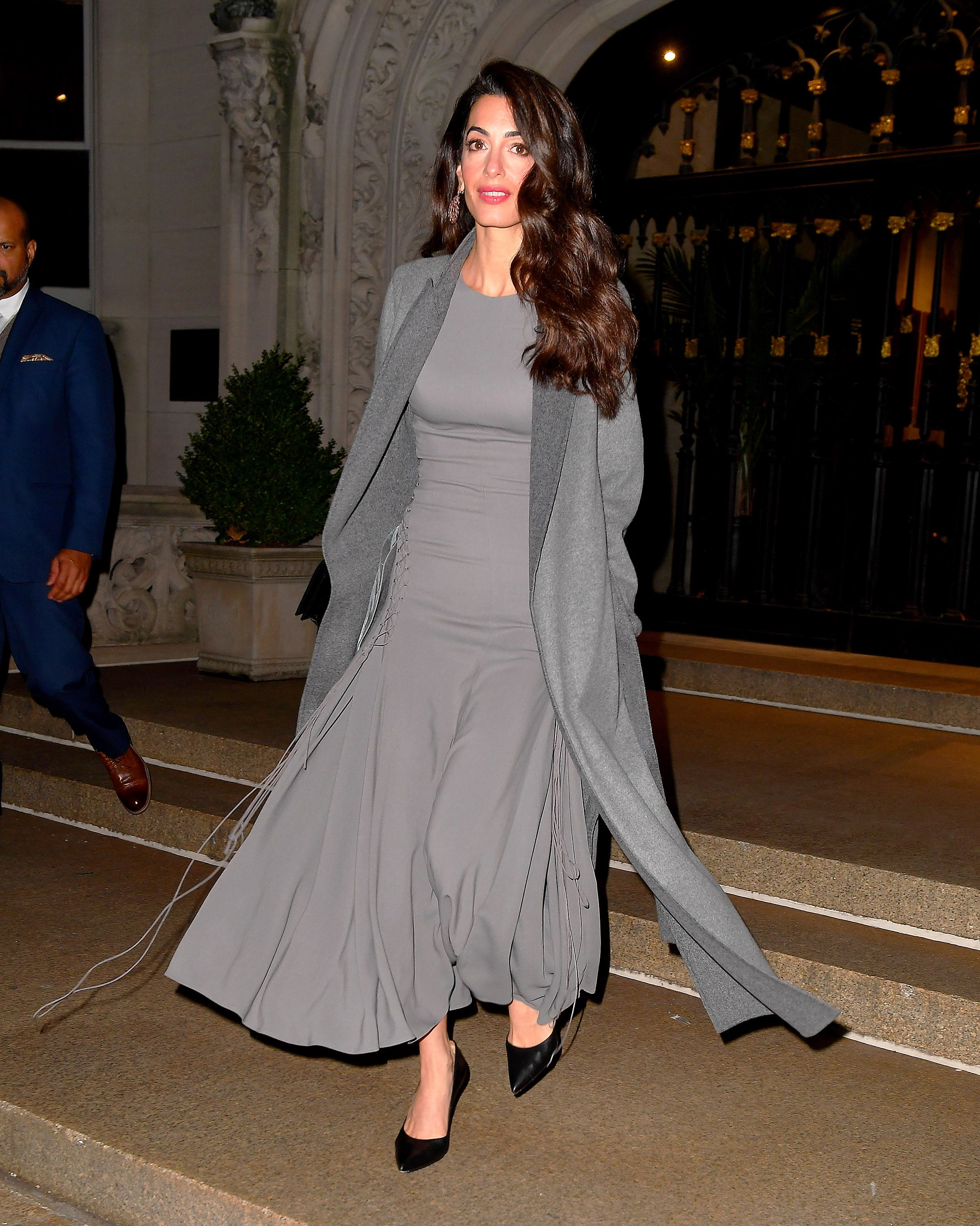 EXCLUSIVE: Amal Clooney seen wearing a grey coat and grey dress in New York City