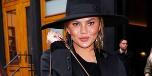 Chrissy Teigen brings a big bad of clothes when out and about in New York