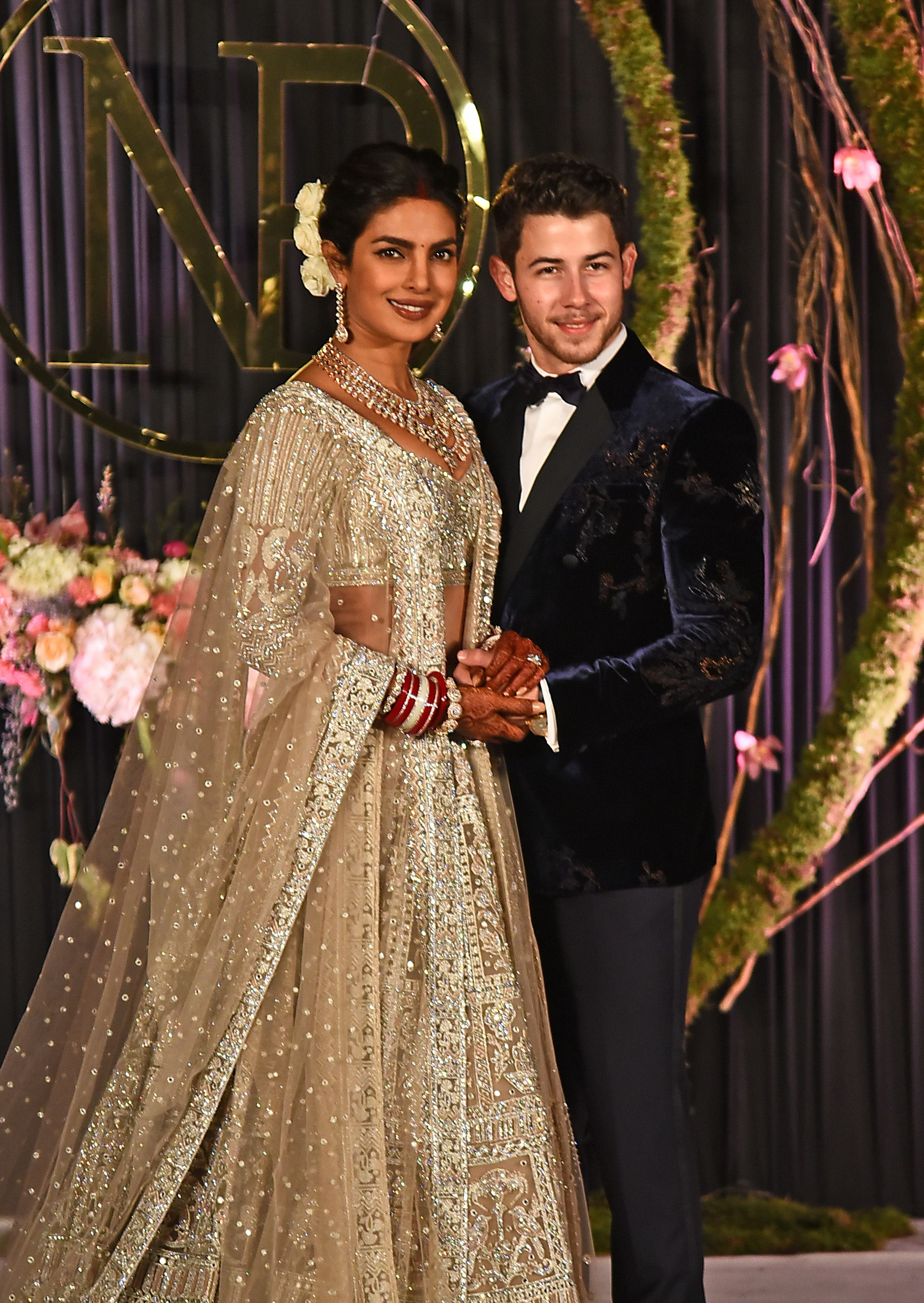 98fb0e927c Priyanka Chopra Wears a Champagne Falguni Shane Peacock Outfit for her  Wedding Reception