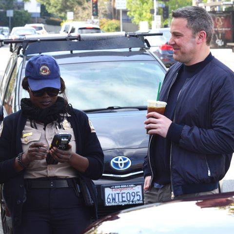 Ben Affleck Has A Laugh With Parking Enforcement Officer As He Get Two Tickets While Grabbing A Drink From Starbucks In Brentwood, CA