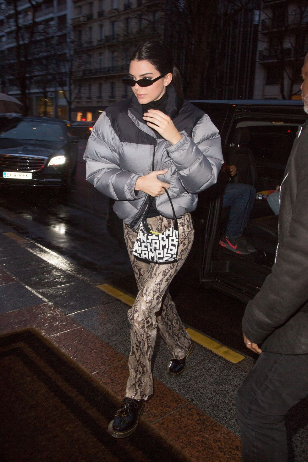 March 14, 2019 The star bundled up for the rainy weather in a silver puffer jacket and spiced things up with snakeskin pants.