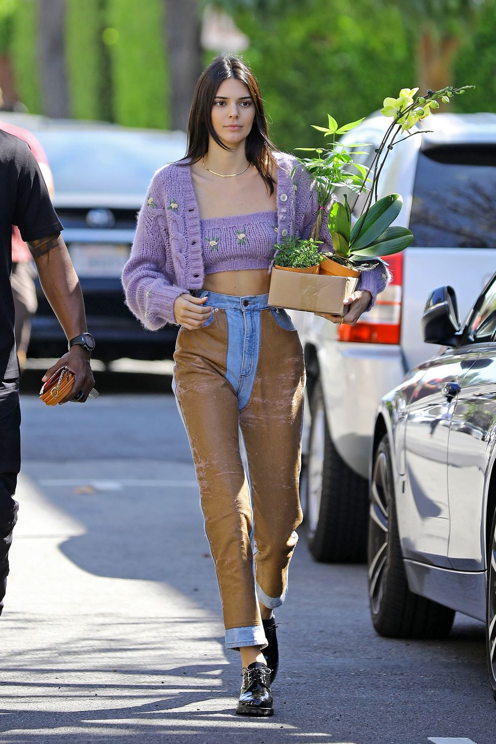 April 6, 2019 Kendall's purple knit set was perfect for a nice spring day. She wore it with a pair of unique jeans that came with patches of brown on the front.