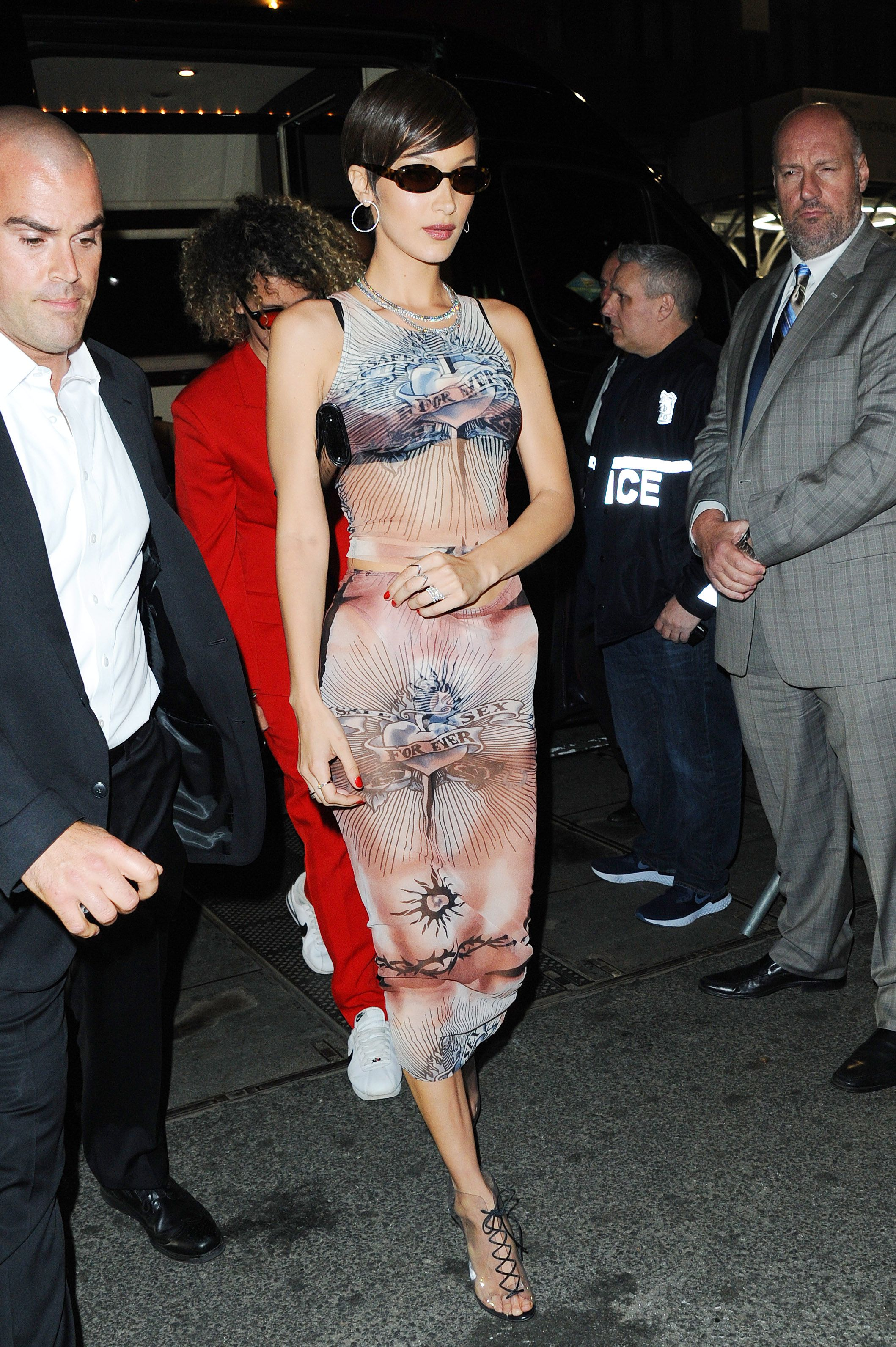 Bella Hadid Bella slipped off her bejeweled Moschino gown for a simple printed dress and lace up heels.