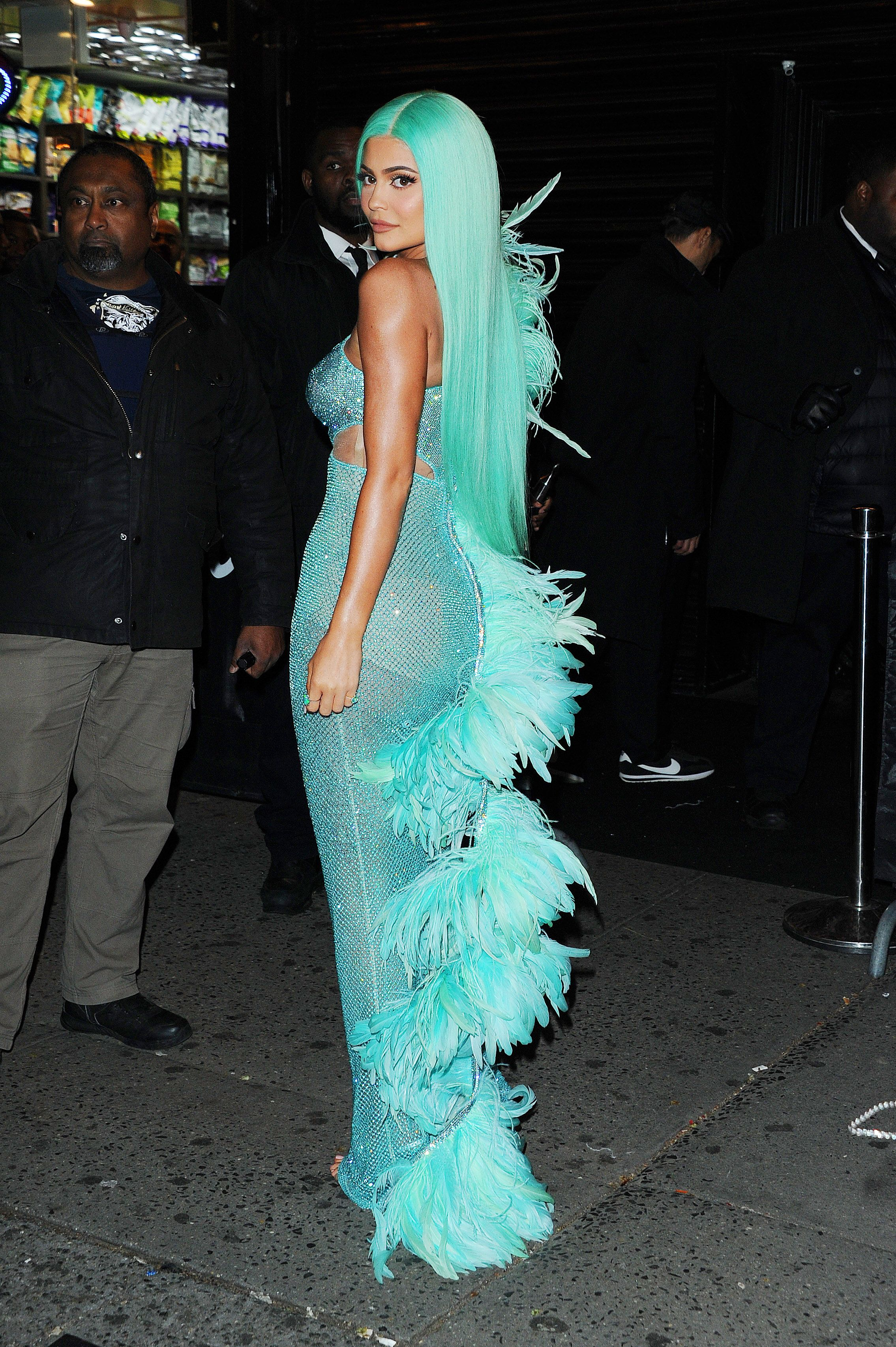 Kylie Jenner Having walked the red carpet in a lavender flourish, Kylie swapped out the purple for a turquoise sequin dress covered in feathers, plus a matching wig to complete the co-ordinated colors.