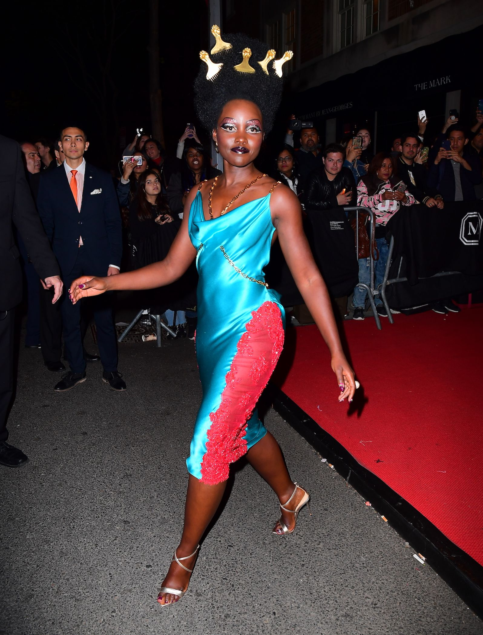 Lupita Nyong'o The actress ditched her voluminous gown for a more body-hugging dress.