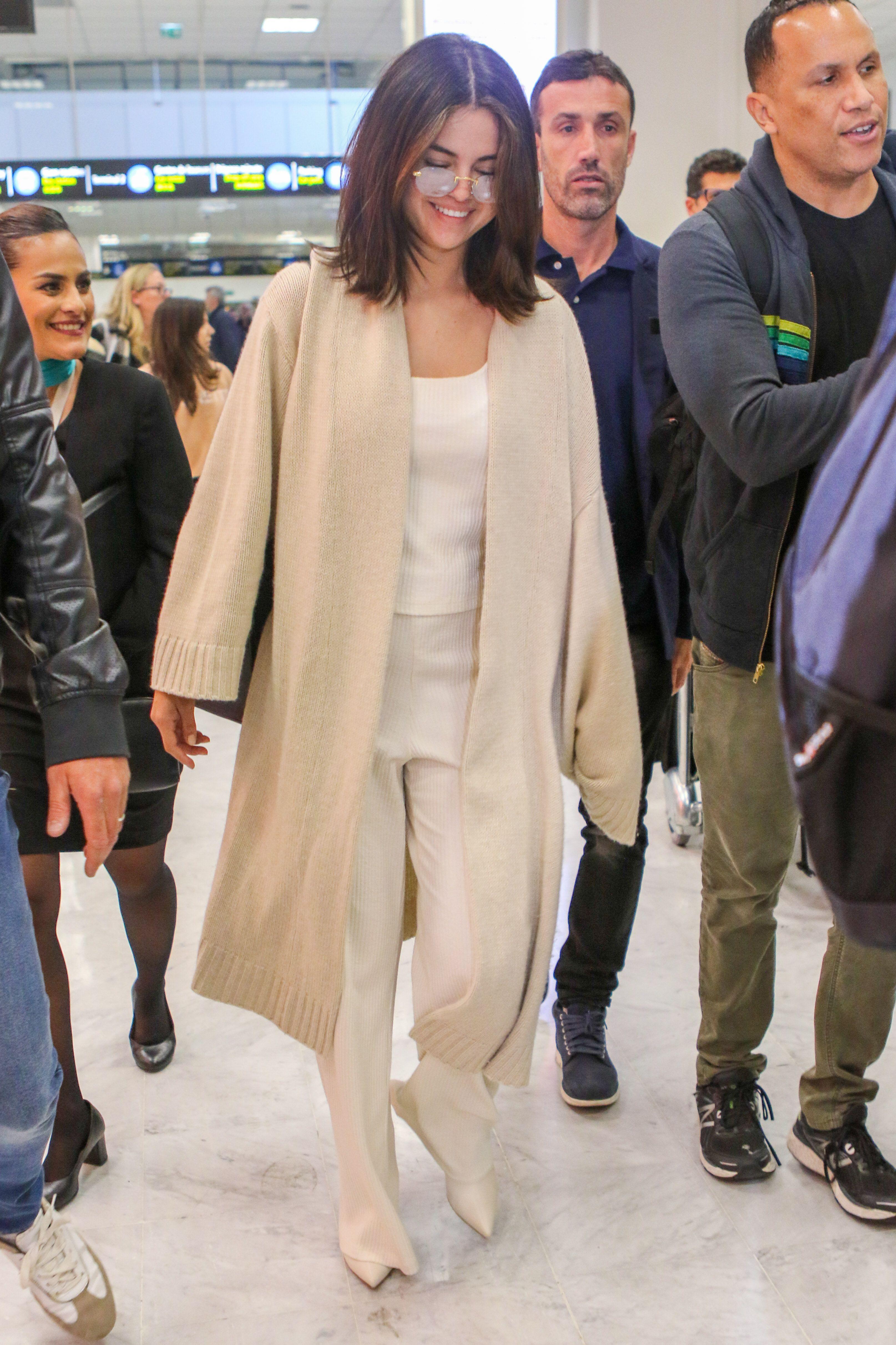 Selena Gomez Wore the Coziest Cream Cardigan to Travel to Nice, France