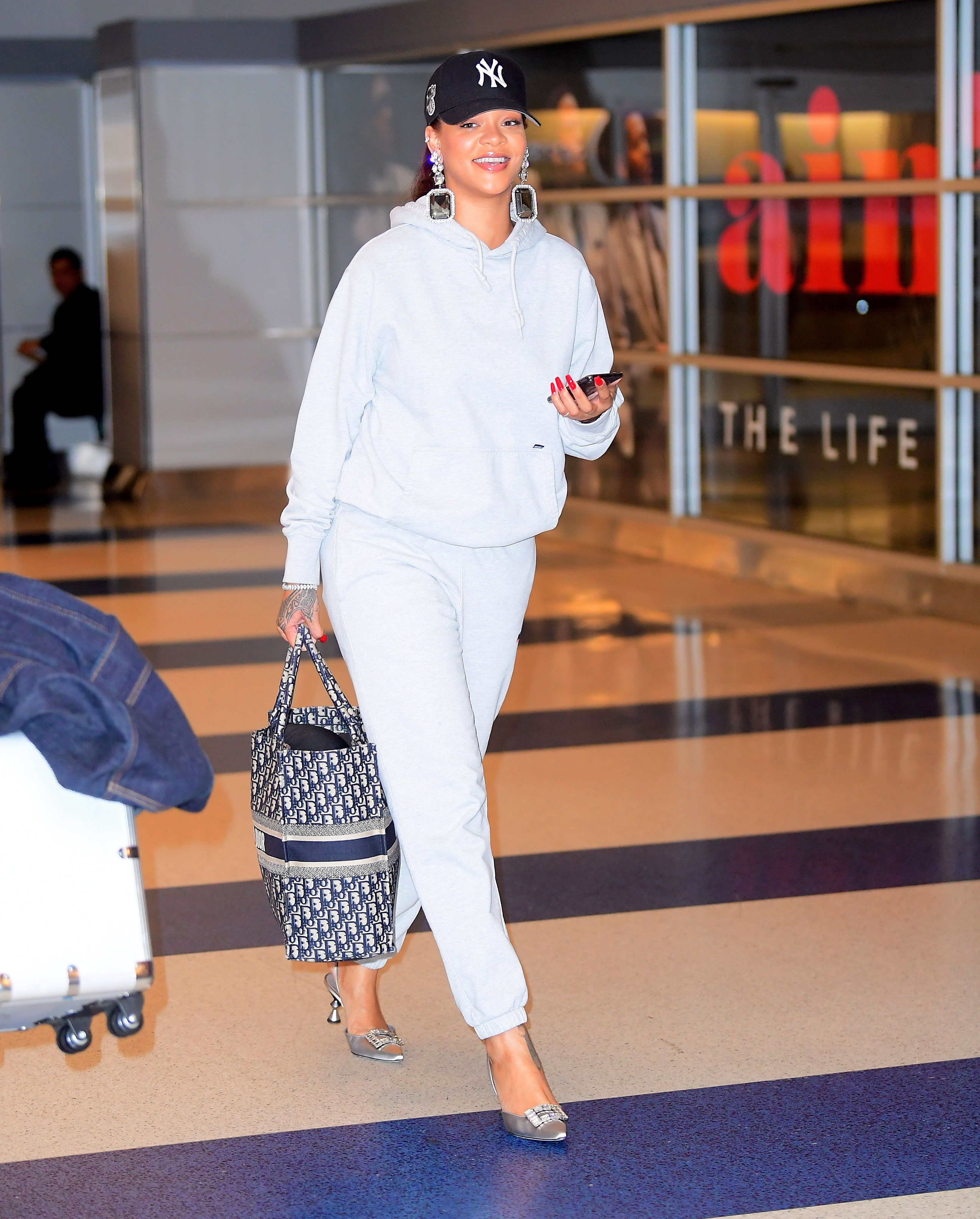 Rihanna Flawlessly Paired Manolo Blahnik Heels With Sweats at the Airport