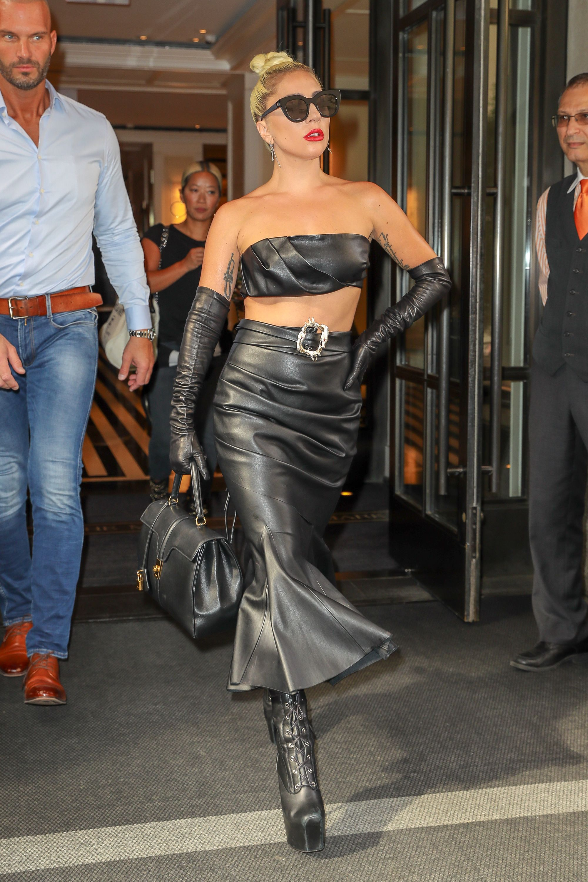 Here's Lady Gaga Wearing the Most Extra Leather Crop Top, Skirt, and Evening Gloves