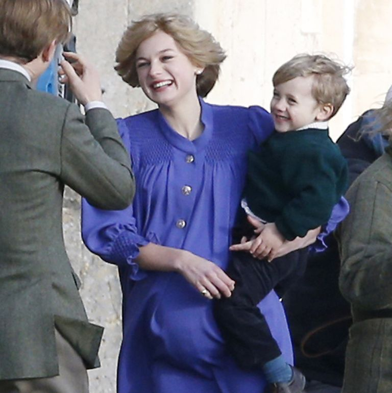 see emma corrin as a pregnant princess diana playing with a young prince william in the crown see emma corrin as a pregnant princess