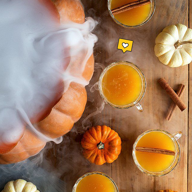 a pumpkin containing punch with fog coming out of the top