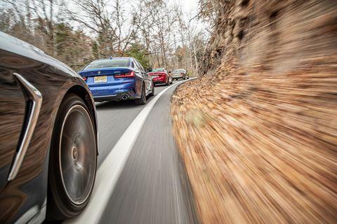 Motor vehicle, Mode of transport, Automotive design, Automotive tire, Road, Automotive lighting, Infrastructure, Rim, Automotive exterior, Alloy wheel,