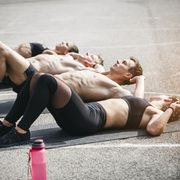 Sportive team during situps