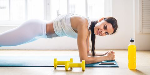 Sportive Woman Training At Home