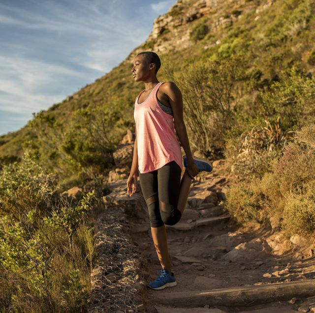 sportive young woman exercising on a mountain trail