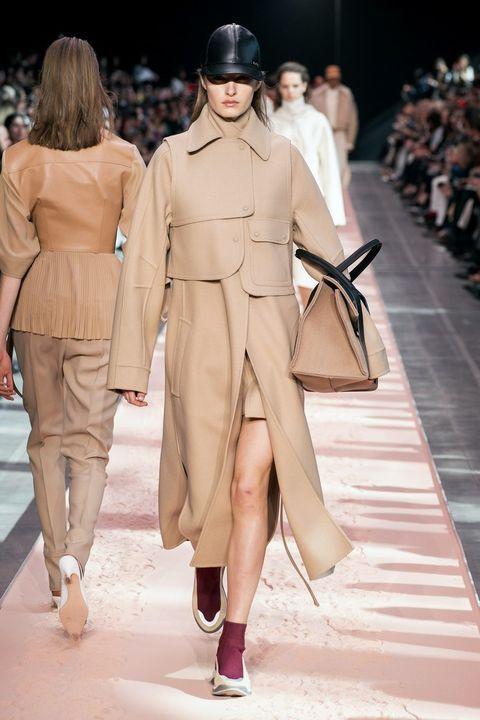 Fashion model, Fashion, Fashion show, Runway, Clothing, Shoulder, Haute couture, Coat, Public event, Outerwear,
