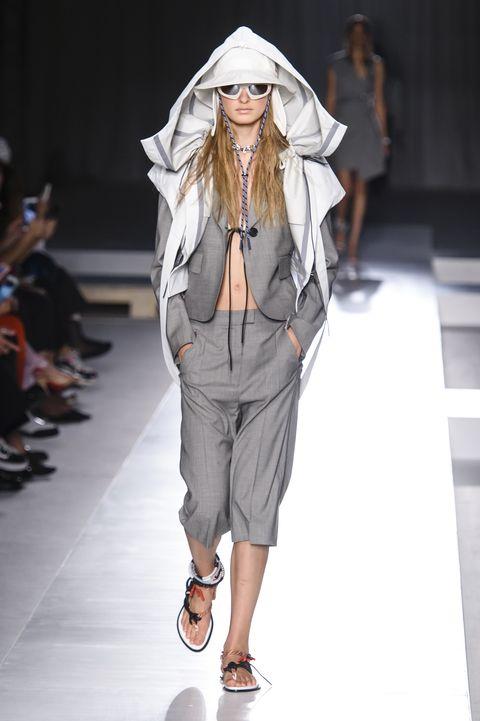 Fashion model, Fashion show, Fashion, Runway, Clothing, Outerwear, Footwear, Human, Event, Fashion design,