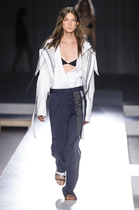 Fashion model, Fashion show, Fashion, Runway, White, Clothing, Fashion design, Outerwear, Public event, Waist,