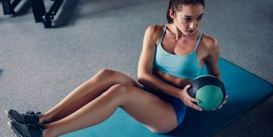 Sports woman in gym.
