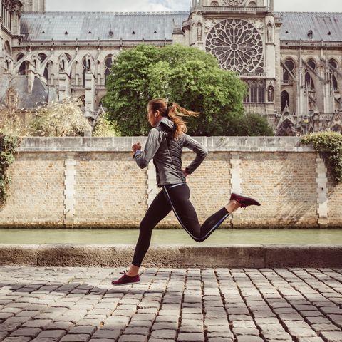 Sports woman jogging in Paris