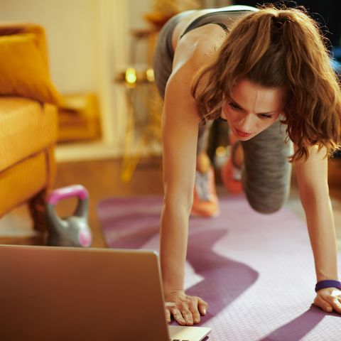 sports woman using online streaming fitness site