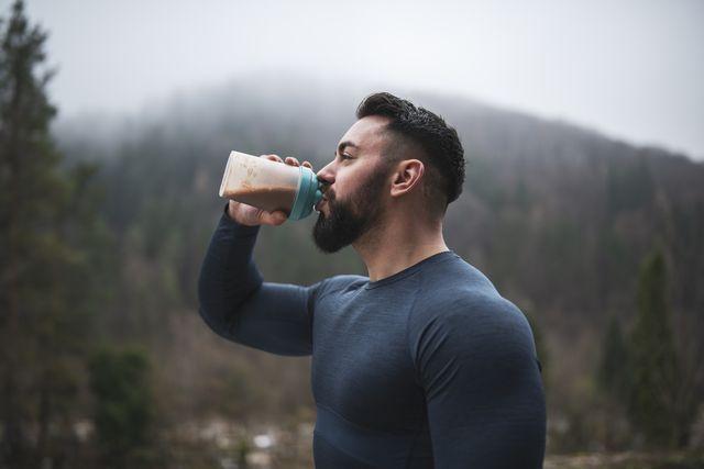 sportsman drinking protein outdoor