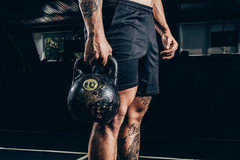 sportsman holding kettlebell